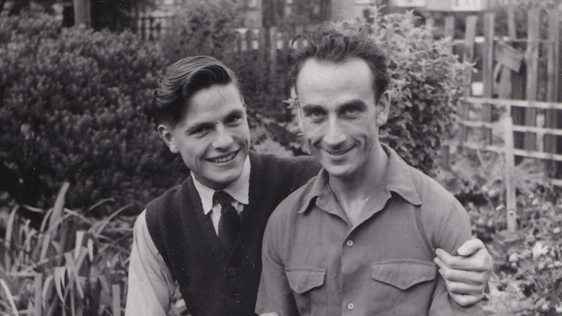 Reg and George pictured in black & white in their garden in the 1950s from the LGBT short film Rhiw Goch